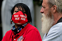 """An attendee wears a """"Make America Great Again"""" protective mask during a Rolling to Remember ceremony honoring the nation's veterans and prisoners of war/missing in action (POW/MIA) in Washington, D.C., U.S., on Friday, May 22, 2020. United States President Donald J. Trump didn't wear a face mask during most of his tour of Ford Motor Co.'s ventilator facility Thursday, defying the automaker's policies and seeking to portray an image of normalcy even as American coronavirus deaths approach 100,000. <br /> Credit: Andrew Harrer / Pool via CNP /MediaPunch"""