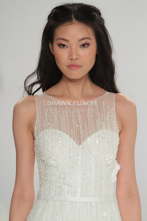 "Beauty shot: model walks runway in Olwen - an off white mermaid-cut tulle dress with vertical lines of crystal embroidery and a belt on the waistline, from the Tony Ward Fall 2016 ""A Mid-Summer Night's Dream"" bridal collection on April 18, 2016 at Kleinfeld Bridal during New York Bridal Fashion Week Spring Summer 2016."
