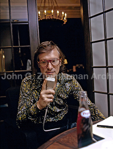 Hugh Hefner working at his Chicago mansion, 1973. Photo by John G. Zimmerman.