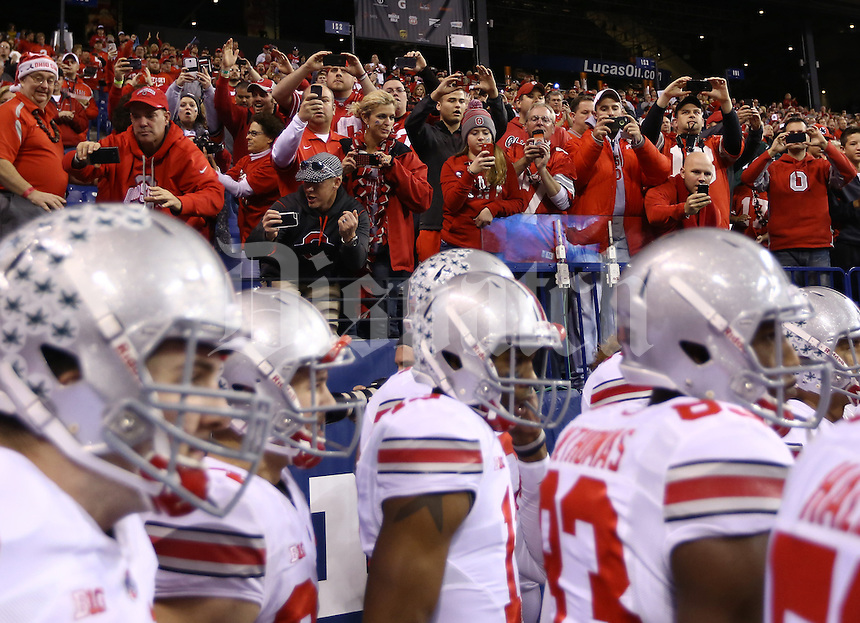Buckeye fans cheer as Ohio State players enter the field for warm-ups prior to the Big Ten championship football game between the Buckeyes and the Michigan State Spartans at Lucas Oil Stadium in Indianapolis on Dec. 7, 2013. (Adam Cairns / The Columbus Dispatch)