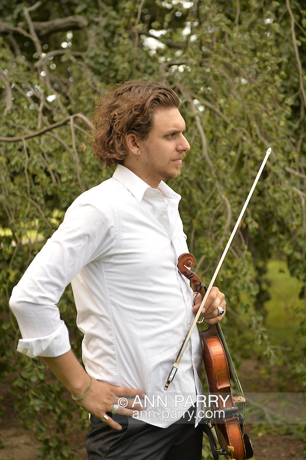 Old Westbury, New York, U.S. - June 21, 2014 - JESSE KOTANSKY, on violin, performs live music during Lori Belilove & The Isadora Duncan Dance Company dances during the Midsummer Night event at the historic Long Island Gold Coast estate of Old Westbury Gardens on the first day of summer, the summer solstice.