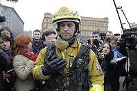 Moscow, Russia, 29/03/2010..Scenes outside Lubyanka metro station, where at least 24 people were killed in a morning rush hour suicide bombing. A second bomb exploded at Park Kultury metro station, killing at least another 14 people. Unofficial rescue worker surrounded by media at the scene..
