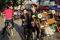 Former rural residents buy childcare products on the edge of Liaocheng city. They are moved from their farmland several years ago and resettled nearby in purpose-built estate. China is hoping by relocating farmers into cities they would start to buy food, making a break from the cycle of farmers consuming only what they produce. The Chinese government plans to move 250 million rural residents into urban areas over the coming dozen years though it is unclear whether people want to move and where the money for this project will come from. Further urbanisation is meant to drive up consumption to counterbalance an export orientated economy and end subsistence farming but the drive to get people off the land is causing tens of thousands of protests each year. /Felix Features