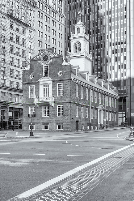 The Old State House on the Freedom Trail amongst the modern buildings in the Financial District of Boston, Massachusetts.  The Old State House was built in 1713.