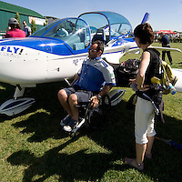 "WeFly team: L'unica pattuglia al mondo su velivoli ultraleggeri composta da piloti disabili, rappresentanti dei ""BARONI ROTTI"".Alessandro Paleri in procinto di salire sull'aereo per l'esibizione...The only FLYING TEAM on microlight composed by disabled pilot in the world, representatives of the BARONI ROTTI.Alessandro Paleri about to board the plane for the exhibition."