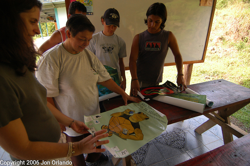 Students and teachers discuss options for what to paint on the mural at their school in Sevegre, a rural town Costa Rica.  The mural will will point out the importance of protecting the environment.
