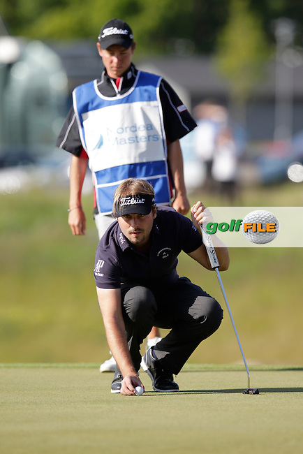 Victor Dubuisson (FRA) lines up his putt on the playoff hole during Sunday's Final Round of the 2014 Nordea Masters held at the PGA of Sweden National Lakes Course, Malmo, Sweden.1st June 2014.<br /> Picture: Eoin Clarke www.golffile.ie