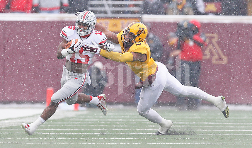 Ohio State Buckeyes running back Ezekiel Elliott (15) makes some yardage after a short reception as Minnesota Golden Gophers linebacker Damien Wilson (5) tries to bring him down in the first quarter at TCF Bank Stadium on November 15, 2014. (Chris Russell/Dispatch Photo)
