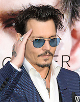 "WESTWOOD, LOS ANGELES, CA, USA - APRIL 10: Actor Johnny Depp arrives at the Los Angeles Premiere Of Warner Bros. Pictures And Alcon Entertainment's ""Transcendence"" held at Regency Village Theatre on April 10, 2014 in Westwood, Los Angeles, California, United States. (Photo by Xavier Collin/Celebrity Monitor)"