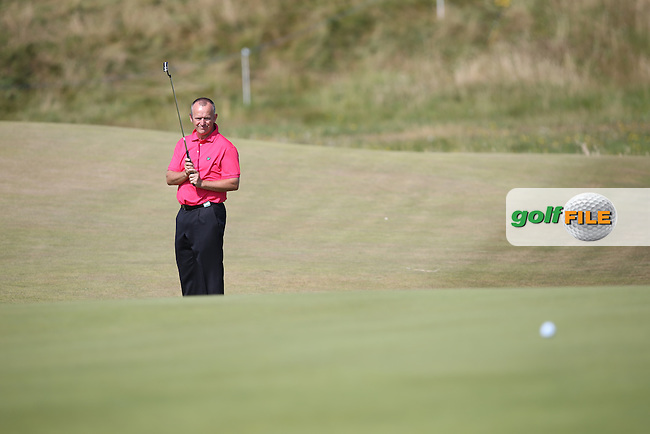 Jamie Spence (ENG) putts up the 5th during Round One of the 2014 Senior Open Championship presented by Rolex from Royal Porthcawl Golf Club, Porthcawl, Wales. Picture:  David Lloyd / www.golffile.ie