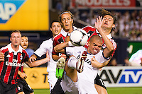 Pepe (3) of Real Madrid and Francesco Acerbi (13) of A. C. Milan battle for the ball. Real Madrid defeated A. C. Milan 5-1 during a 2012 Herbalife World Football Challenge match at Yankee Stadium in New York, NY, on August 8, 2012.