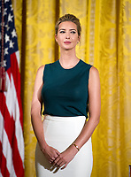 Ivanka Trump listens as United States President Donald J. Trump participates in an event with small businesses in the East Room of the White House in Washington, DC on Tuesday, August 1, 2017. Photo Credit: Ron Sachs/CNP/AdMedia