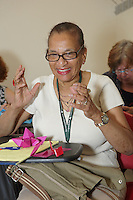 OrigamiUSA 2016 Convention at St. John's University, Queens, New York, USA. Delrosa Marshall, New York, in a class taught by Scott Cramer, Rock Crystal.