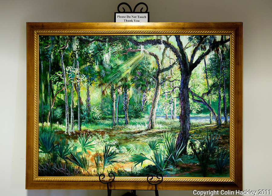 SUNBEAMS AND PALM TREES: An oil painting of a Florida scene by Highwaymen Artist Robert Butler is part of the art collection at The Black Archives in Tallahassee..COLIN HACKLEY PHOTO