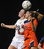 Isabelle Glennon #20 of North Shore, left, and Laura Ferraris #23 of Manhasset go up for a header during the Nassau County varsity girls soccer Class A final at Cold Spring Harbor High School on Friday, Nov. 3, 2017. Glennon scored one goal in North Shore's 4-2 win.
