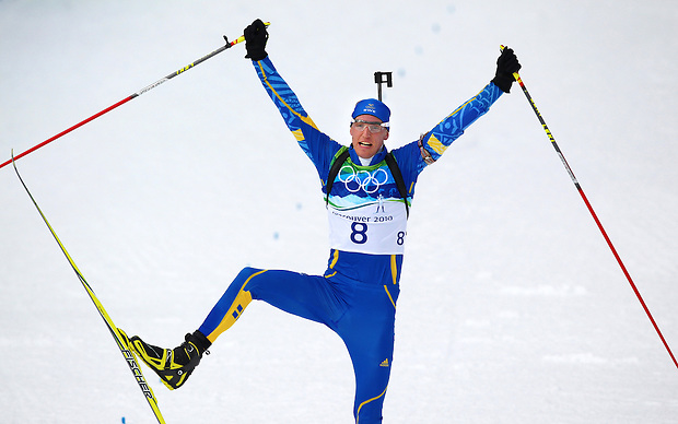 Sweden's Bjorn Ferry raises a ski while crossing the finish line to win gold in the men's 12.5 k pursuit biathlon at the XXI Olympic Winter Games Tuesday, February, 16, 2010 at Whistler Olympic Park in Whistler, British Columbia.