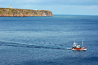 Fishing boat navigating around the Cap Frehel peninsula, Brittany, France.