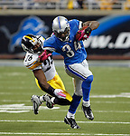 Pittsburgh Steelers cornerback Deshea Townsend (26) grabs onto the uniform of Detroit Lions running back Kevin Smith (34) on the carry, in the fourth quarter of an NFL football game, Sunday, Oct. 11, 2009, in Detroit. Pittsburgh won 28-20. (AP Photo/Tony Ding)