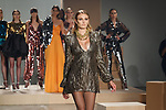 Model walks runway in a gold chain sequin GABRIELE dress with gathered shoulder detail and skater style skirt, from the Greta Constantine Spring Summer 2018 collection by Kirk Pickersgill and Stephen Wong on September 6, 2017; at Pier 59 Studios during New York Fashion Week. Horizontal