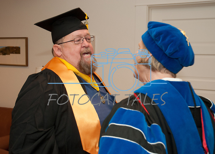 WNC Information Technology student Steve Vaughn, left,  talks with Dr. Doris Dwyer prior to commencement at the Western Nevada College in Fallon, Nev., on Tuesday, May 20, 2014. <br /> Photo by Kim Lamb