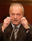 "Washington, D.C. - May 17, 2005 -- George Galloway , Member of Parliament for Bethnal Green and Bow , Great Britain, puts on his glasses as he testifies before the United States Senate Committee on Homeland Security and Governmental Affairs Permanent Subcommittee on Investigations hearing on ""Oil For Influence: How Saddam Used Oil to Reward Politicians Under the United Nations Oil-for-Food Program"" in Washington, D.C. on May 17, 2005.  .Credit: Ron Sachs / CNP"