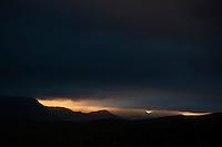 Ray of light silhouette stormy mountain landscape, Vestvagoy, Lofoten islands, Norway