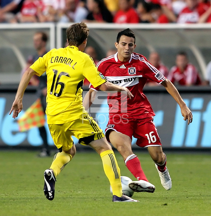 Chicago Fire midfielder Marco Pappa (16) makes a move to get around Columbus Crew midfielder Brian Carroll (16).  The Chicago Fire tied the Columbus Crew 0-0 at Toyota Park in Bridgeview, IL on July 11, 2009.