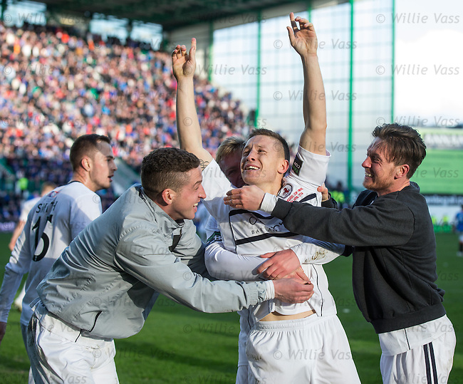 John Baird celebrates