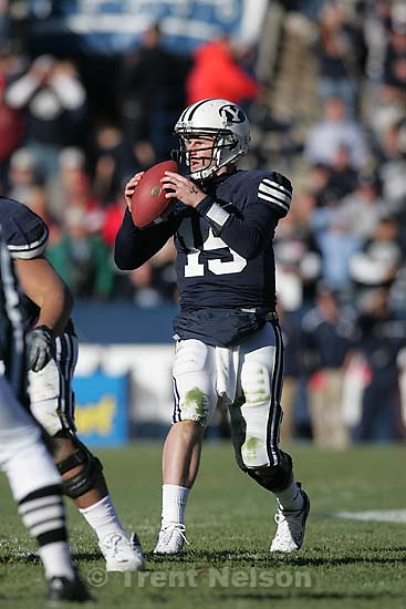 Provo - Brigham Young quarterback Max Hall (15) scrambles on a fourth down, 4th quarter, as BYU defeats the University of Utah 17-10 in college football action Saturday at BYU's Lavell Edward Stadium.