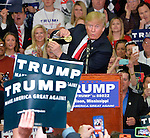 3/7/2016 Madison,Mississippi On the eve of the Mississippi Presidential Primary Presidential Republican candidate Donald J. Trump stumps to a crowd of Southern voters at Madison Central High School gymnasium. Trump was given a gold key to the City of Madison, by the Mayor Mary Hawkins, Trump proudly showed it off to the crowd and then put it in his pocket. Trump asks the audience to raise their right hands and pledge to vote for him in the primary. Trump spoke about making America great again as Black Lives Matter protestors demonstrated outside. Photo ©Suzi Altman