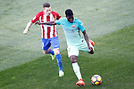 Atletico de Madrid's Kevin Gameiro (l) and FC Barcelona's Samuel Umtiti during La Liga match. February 26,2017. (ALTERPHOTOS/Acero)