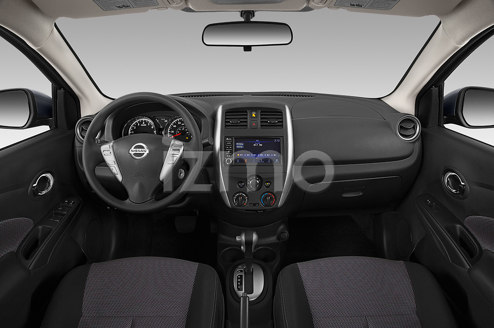 Stock photo of straight dashboard view of 2019 Nissan Versa-Sedan SV 4 Door Sedan Dashboard