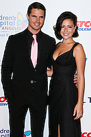 LOS ANGELES, CA, USA - OCTOBER 11: Robbie Amell, Italia Ricci arrive at the Children's Hospital Los Angeles' Gala Noche De Ninos 2014 held at the L.A. Live Event Deck on October 11, 2014 in Los Angeles, California, United States. (Photo by Xavier Collin/Celebrity Monitor)