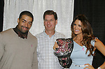 Mark poses with WWE's Eve and David Otunga as they highlight the 10th Annual Connecticut Women's Expo on September 23, 2012 in Hartford, Connecticut where they signed and posed for photos.  (Photo by Sue Coflin/Max Photos)