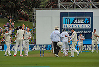 Black Caps players congratulate Doug Bracewell on a wicket during day one of the 2nd cricket test match between the New Zealand Black Caps and Sri Lanka at the Hawkins Basin Reserve, Wellington, New Zealand on Saturday, 3 February 2015. Photo: Dave Lintott / lintottphoto.co.nz