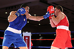 Joshua Temple, left, and Patrick Ferguson compete in the U.S. Olympic Boxing Trials in Reno, Nev., on Wednesday, Dec. 9, 2015. (AP Photo/Cathleen Allison)