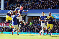 Pictured: Jonathan de Guzman of Swansea (L) scoring his equaliser with a header making the score 1-1. Sunday 16 February 2014<br /> Re: FA Cup, Everton v Swansea City FC at Goodison Park, Liverpool, UK.