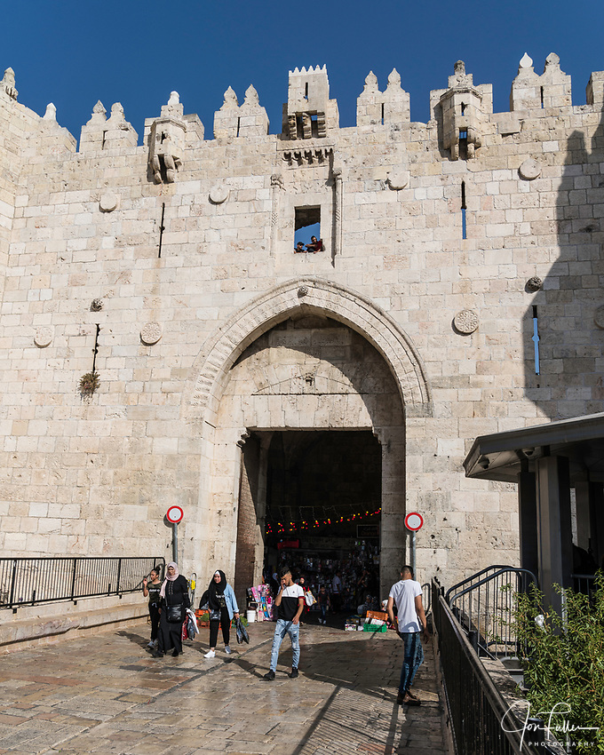 Muslim women in traditional dress by the Damascus Gate on the north side of the Old City of Jerusalem.  The Old City of Jerusalem and its Walls - UNESCO World Heritage Site