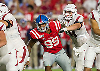 NWA Democrat-Gazette/BEN GOFF @NWABENGOFF<br /> Dalton Wagner, Arkansas right tackle, blocks Charles Wiley (99), Ole Miss linebacker, in the second quarter Saturday, Sept. 7, 2019, at Vaught-Hemingway Stadium in Oxford, Miss.