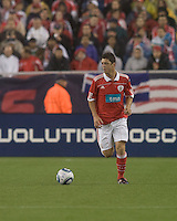 SL Benfica midfielder Filipe Menezes (24) brings the ball forward. SL Benfica  defeated New England Revolution, 4-0, at Gillette Stadium on May 19, 2010.