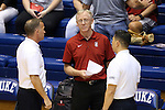 11 September 2015: Stanford head coach John Dunning talks to the referees before the game. The Duke University Devils hosted the Stanford University Cardinal at Cameron Indoor Stadium in Durham, NC in a 2015 NCAA Division I Women's Volleyball contest. Stanford won the match 3-2 (17-25, 25-22, 17-25, 25-23, 10-15).