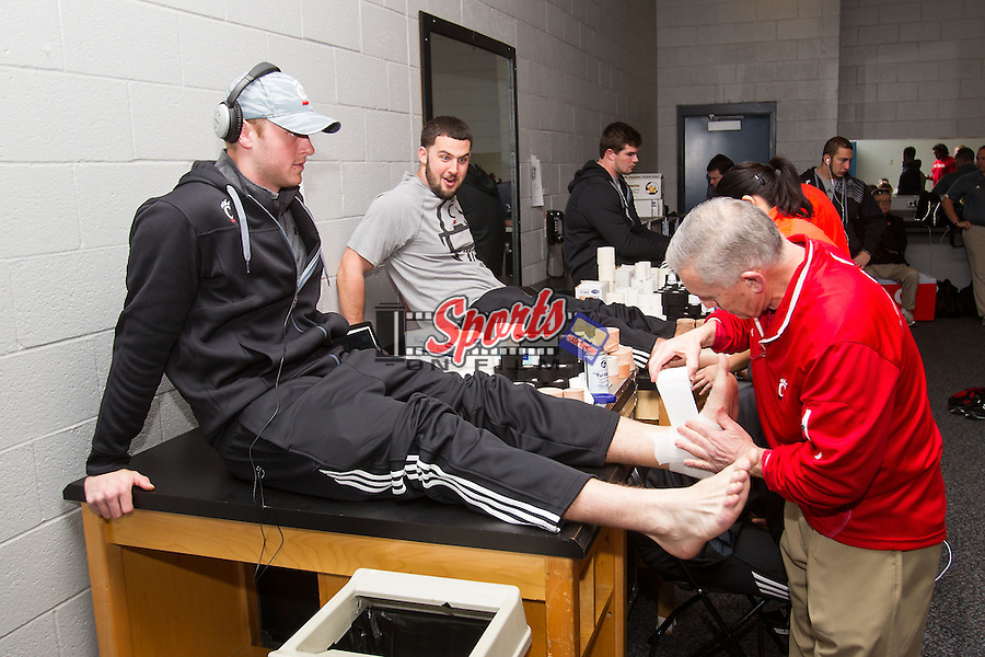 Cincinnati Bearcats quarterback Brendon Kaye gets his ankle taped prior to the Belk Bowl against the North Carolina Tar Heels at Bank of America Stadium on December 28, 2013 in Charlotte, North Carolina.  The Tar Heels defeated the Bearcats 39-17.   (Brian Westerholt/Sports On Film)