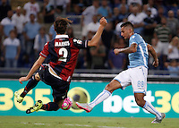 Calcio, Serie A: Lazio vs Bologna. Roma, stadio Olimpico, 22 agosto 2015.<br /> Lazio&rsquo;s Ricardo Kishna, right, is challenged by Bologna&rsquo;s Marios Oikonomou during the Italian Serie A football match between Lazio and Bologna at Rome's Olympic stadium, 22 August 2015.<br /> UPDATE IMAGES PRESS/Isabella Bonotto