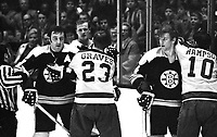 California Golden Seals Hilliard Graves and Ted Hampson with Boston Bruins Phil Esposito and Bobby Orr. (1971 photo/Ron Riesterer)