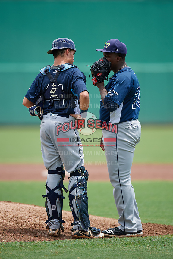 GCL Rays relief pitcher Daiveyon Whittle (23) talks with catcher Dawson Dimon (44) during a game against the GCL Red Sox on August 1, 2018 at JetBlue Park in Fort Myers, Florida.  GCL Red Sox defeated GCL Rays 5-1 in a rain shortened game.  (Mike Janes/Four Seam Images)