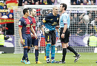 FC Barcelona's Victor Valdes have words with the referee Miguel Angel Perez Lasa in presence of Alexis Sanchez (l) and Andres Iniesta (2l) after La Liga match.March 02,2013. (ALTERPHOTOS/Acero) /NortePhoto