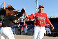 Batavia Muckdogs pitcher Beau Wright #32 high fives mascot Homer while being introduced before a game against the Auburn Doubledays on June 18, 2013 at Dwyer Stadium in Batavia, New York.  Batavia defeated Auburn 10-2.  (Mike Janes/Four Seam Images)