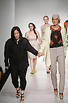 Senior fashion designer Olivia Y. Choi, walks runway with model, at the close of the Pratt 2011 fashion show.