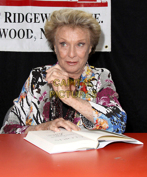 "CLORIS LEACHMAN.Nine-time Emmy Award Winner and Star of Dancing with the Stars signs her new book ""Cloris"" held at Bookends Book Store, Ridgewood, New Jersey, USA,.1st April 2009..half length sitting black white blue multi-coloured print jacket beads necklace .CAP/ADM/PZ.©Paul Zimmerman/Admedia/Capital Pictures"
