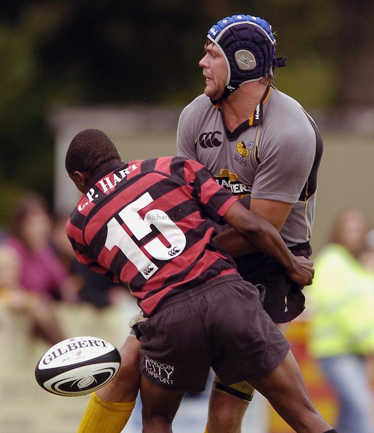 Photo: Jonathan Butler..Wasps A v Blackheath. Pre Season Friendly. 20/08/2006..Tom Palmer of London Wasps ships the ball under pressure from Martin O'Lima of Blackheath.